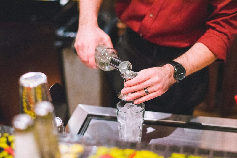 A picture of a bartender pouring tequila